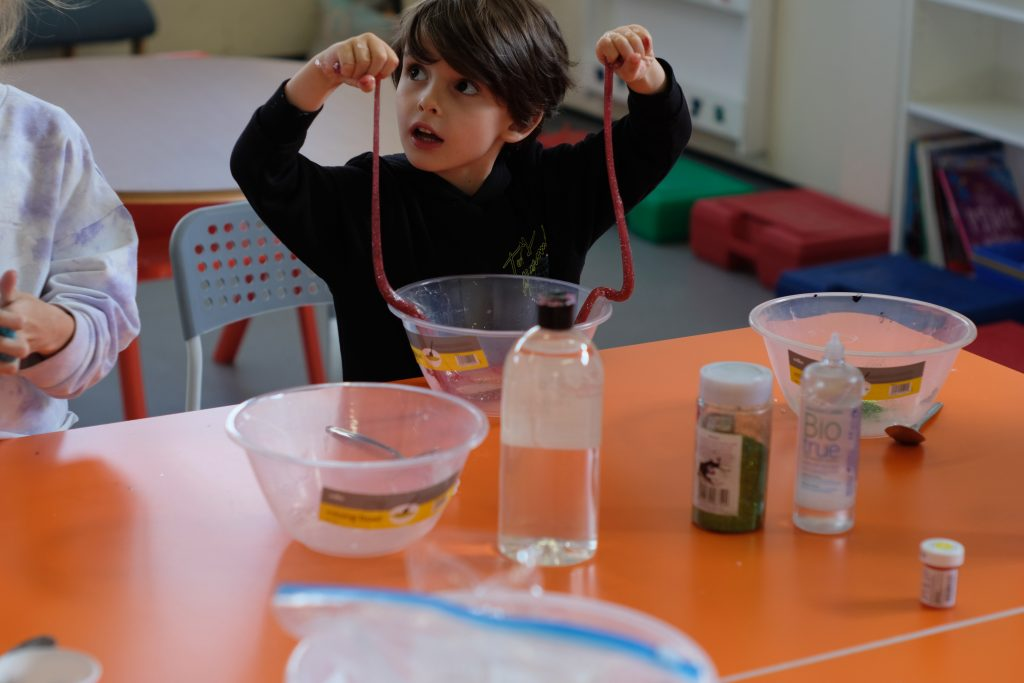 One of our multisensory STEAM workshops where a child makes slime